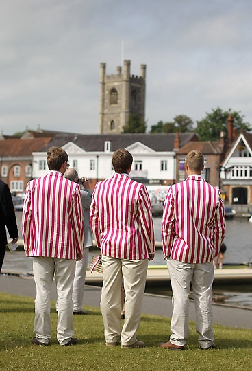 Rowers in traditional blazers watch the action at Henley Royal Regatta on June 28, 2012 in Henley-on-Thames, England. Held since 1839, this social and sporting event is a highlight of the season and takes place along the one mile, 550 yards of Henley Reach. (Photo by Chris Jackson/Getty Images)