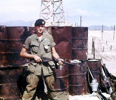A member of the 5th Special Forces Group poses with his weapon in Vietnam