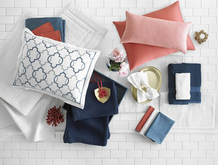 Turn any room into a conversation piece by pairing two strikingly different colors, such as navy blues with vivid corals. Use pops of white to keep things fresh and tie the whole look together.