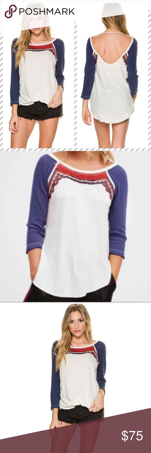 """Free People Embellished Tee Free People Embellished tee. Women's 3/4 sleeve tee. Boat neck. Pullover. Long set-in sleeves. Made from cotton. gorgeous ivory/cream shirt with a navy blue sleeve in boho ethnic style with embroidery and mirror detailing. exposed seams, unfinished edges, light fabric, wide neck with low back. Easy comfortable fit and very cool look!  Chest measures ~19"""" armpit to armpit. Great for spring!  Never worn merely tried on. Free People Tops Tees - Long Sleeve"""