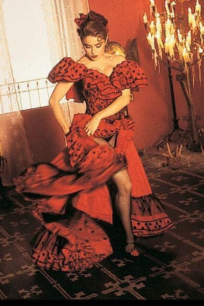 Madonna wearing red and black flamenco style dress in her music video clip for her song 'La Isla Bonita (1987).