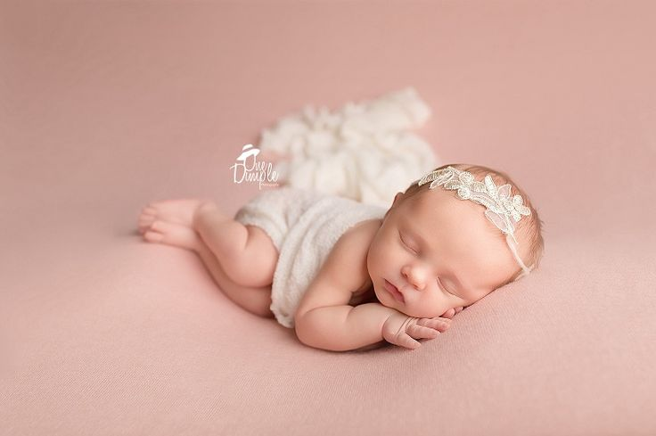 Dfw in home posed newborn session pink and cream slide laying pose