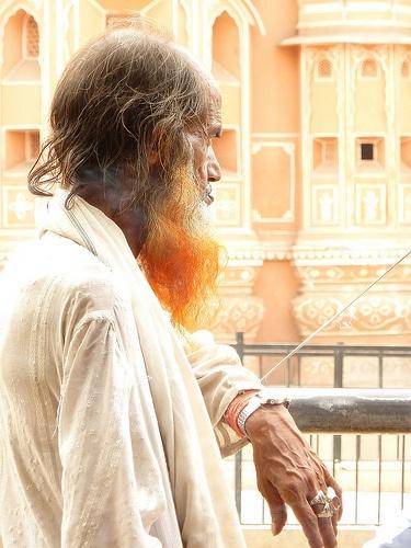 Man in front of Hawa Mahal, Jaipur, India.