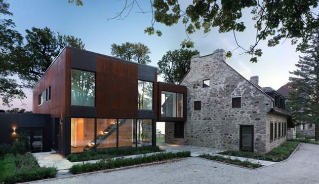 Traditional stone farmhouse extended with glass and steel addition
