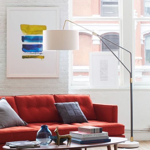 A mid-century take on the arching floor lamp, this antiqued bronze-finished beauty sits on a round marble base. Its adjustable arm lets you direct light where you need it most.