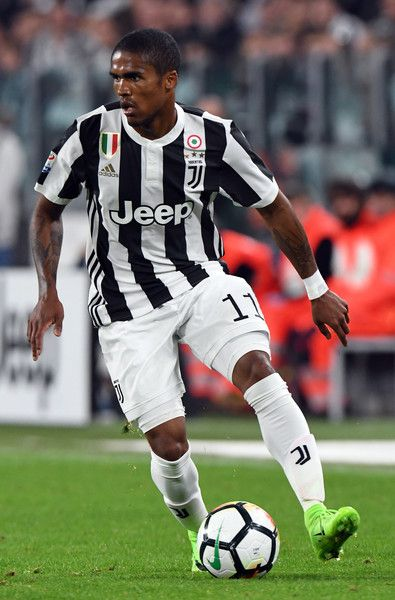 De Suoza Douglas Costa of Juventus in action during the Serie A match between Juventus and Torino FC on September 23, 2017 in Turin, Italy.