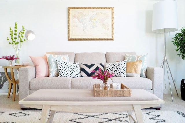 Love the mix of color on the neutral sofa.