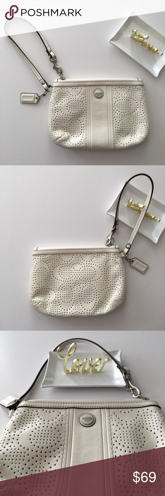 Coach Wristlet NWOT. Authentic beautiful off white leather wristlet with one slot pocket inside and cloth lined. See pics for measurements. Coach Bags Clutches & Wristlets