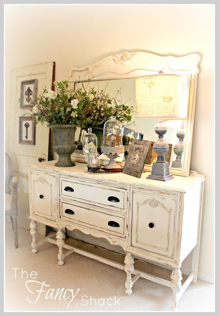 The Fancy Shack: Living Room Reveal! I have a side board just like that...think I will paint it.