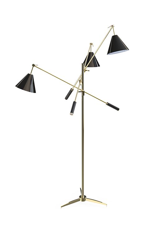 Sinatra standing lamp has a unique sculptural shape. This vintage lamp's structure is handmade in brass and the lampshades in aluminium. It's a versatile lamp which gives a sophisticated and joyful ambiance to any living room or bedroom. A style icon of the fifties and sixties.