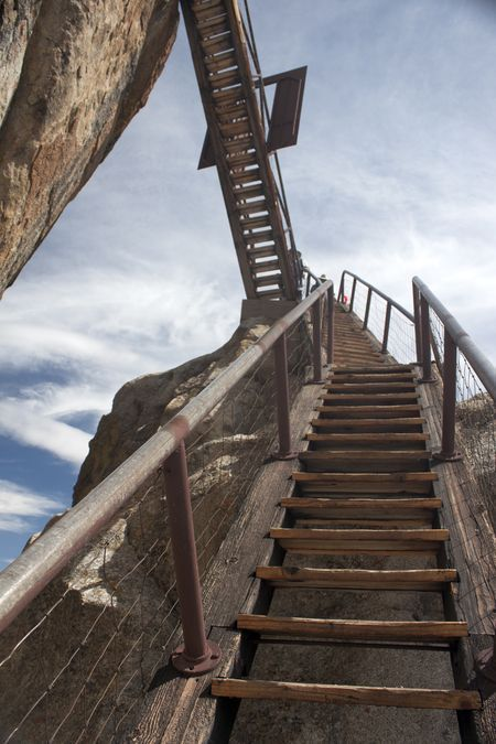 Stair Flights is from Buck Rock Lookout located in the Sequoia National Forest, California. Access to the top of Buck Rock Lookout is via a series of stair flights consisting of 172 steps suspended from the side of the rock built by Frank Fowler and crew was added to ease the climb. The current lookout building was constructed in 1923.