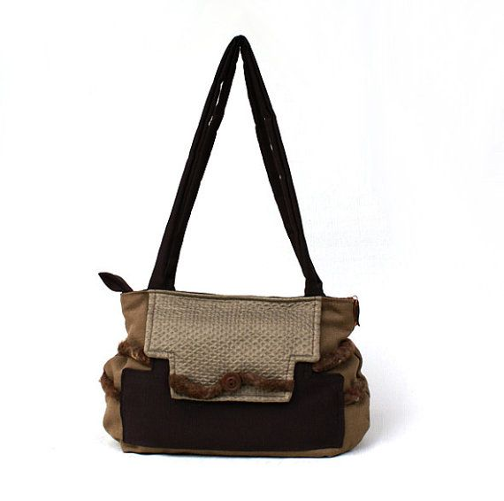 Shoulder bag with double strap, handmade with brown/beige furniture fabric, decorated on the front side with a little cord of wool and a copper button. Secure zip closure, the puller is embellished with a copper pendant in the form of fish.
