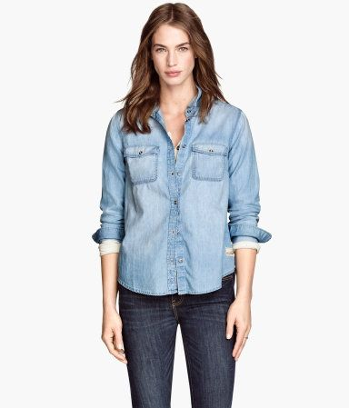 Fitted shirt in soft, washed denim. Chest pockets with flap and button.