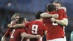 Wales celebrate after Leigh Halfpenny holds his nerve to kick a late penalty and seal a 23-21 win over Ireland in Dublin
