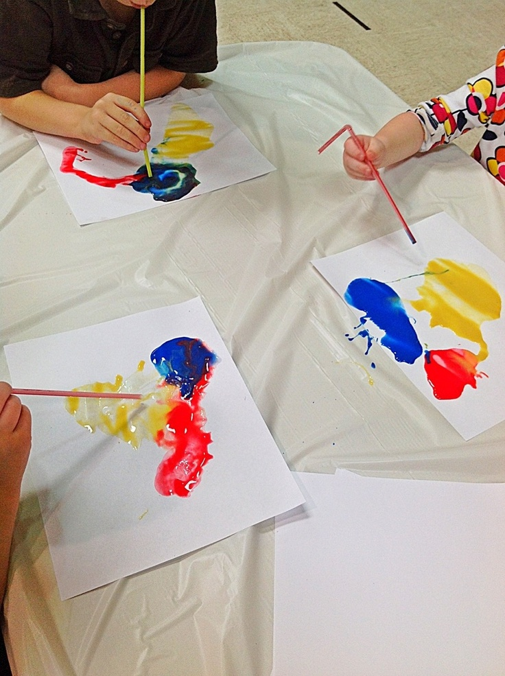 Blow watered down paint with straws to