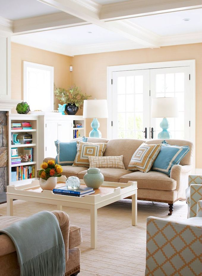 So bright and airy - love the coffered ceiling, and there is just the right touch of turquoise, which looks great with the ochre walls and pillows.