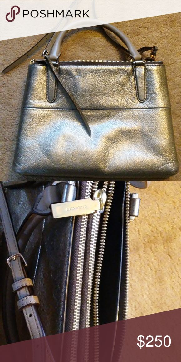 "Coach metallic silver Mini Borough Bag Coach Mini Borough Bag  beautiful metallic silver color 3 zip compartments with multi-function pockets removable, adjustable shoulder strap handles with 4"" drop wonderful condition, like new Coach Bags"