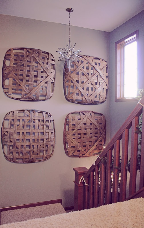 Tabacco Baskets.  I have two.  I don't have stairs but I do have an 18 foot ceiling.  An idea.
