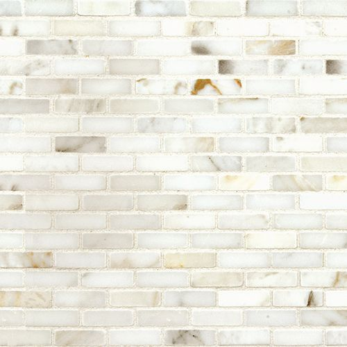 Description:  A classic Italian polished milk white marble accented by soft grey and gold veining in a petite elongated mosaic brick, the shape of which is reflective of the proportions of Roman Bricks used by masons for centuries