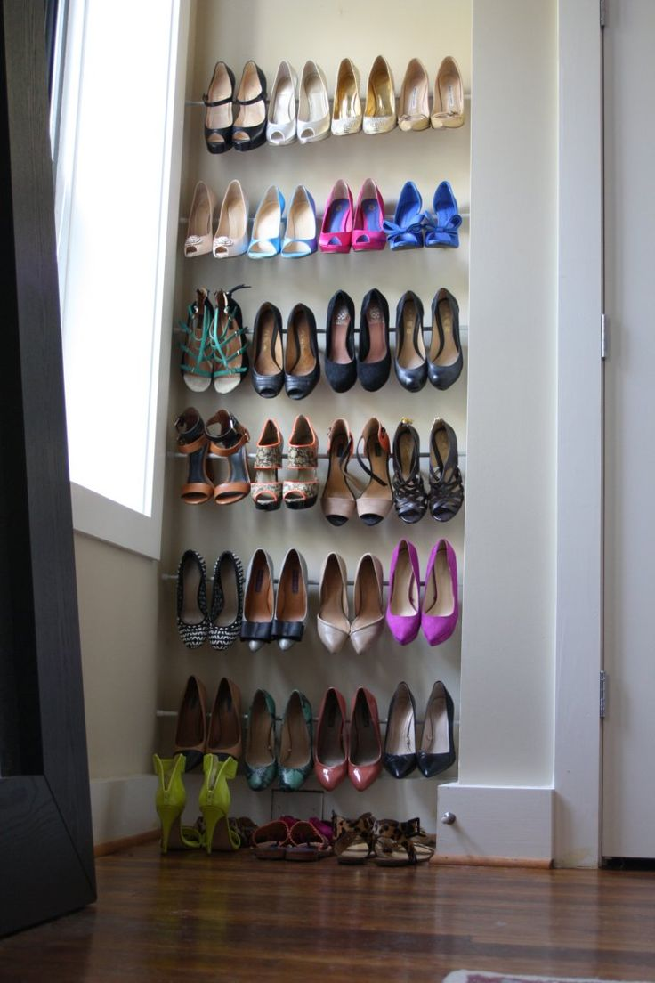 Tension Rods between 2 walls in a niche area of the bedroom. No tools required! #shoes #storage