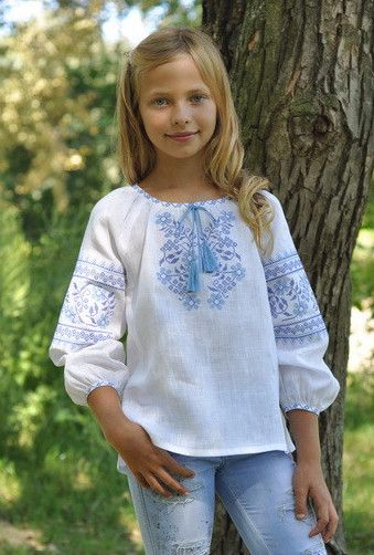 Girl's long sleeve blouse with blue embroidery