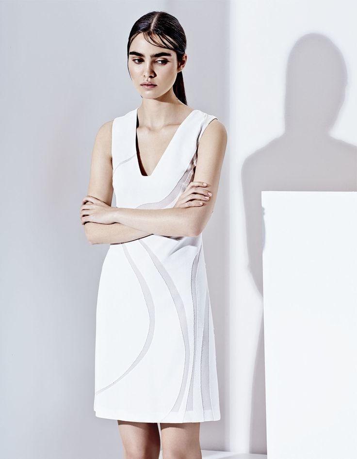 Elegant semi trasparent mini dress, futuristic style