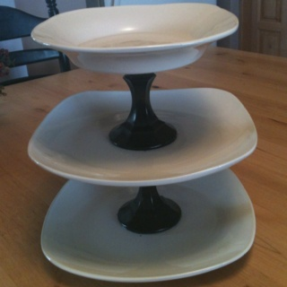 Dollar store plates & candle sticks spray painted black.... $6 total super cute dessert tray!!!!!!