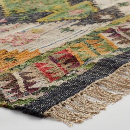Finely handwoven of cotton on a traditional loom, our exclusive flatweave rug features a colorful bohemian design.