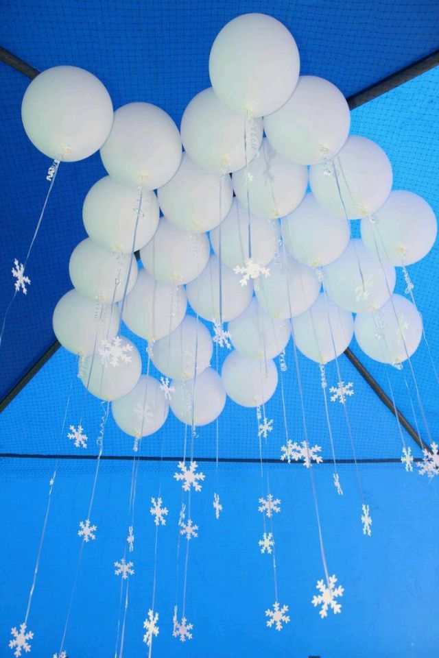 Balloons as clouds with snowflakes attached. Frozen theme party #Christmas #party #decoration