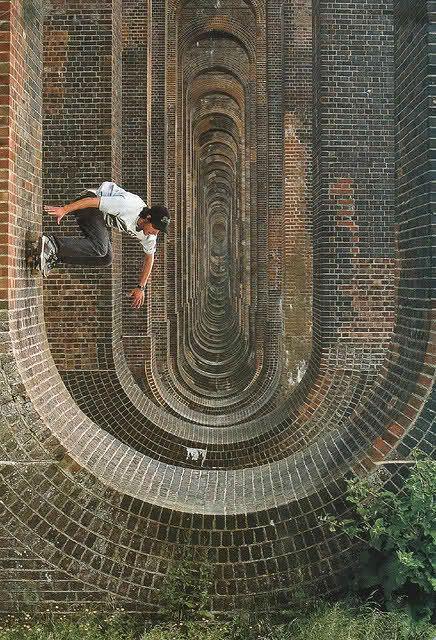 Skateboarder on a brick arch