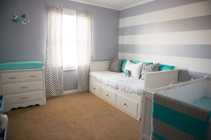 Who says blue is for boys?! We love this gray nursery with aqua accents for a little girl. #nursery