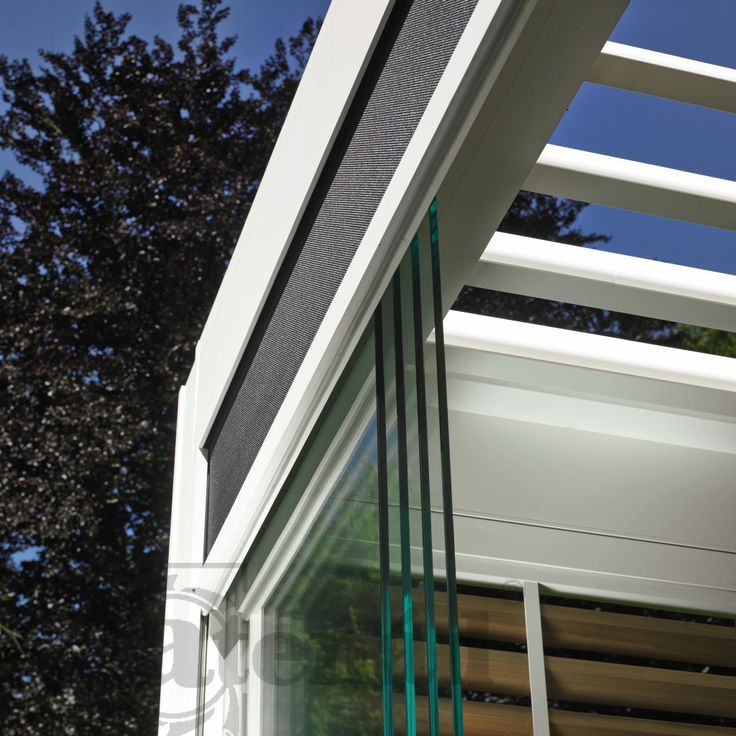 Camargue terrace cover by Renson sliding panels with windtight screens or wooden blades or glass door