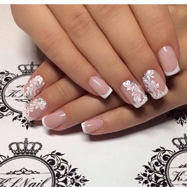 Love the white floral on nude nails.
