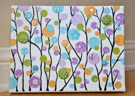 altered canvas using punched circles and buttons