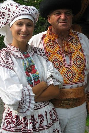 The ornamental decorations on these Slovakian costumes also decorate the log homes of Cicmany, a tradition dating back 200 years. More including video at www.naturalhomes.org/cicmany.htm