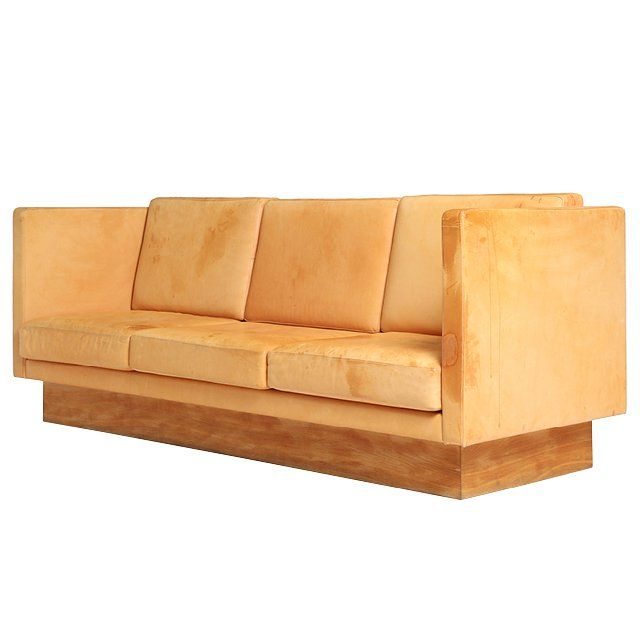 A high-backed natural leather sofa from the 1960s, price upon request For information: wyeth.nyc