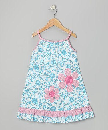 Vestido en color aqua y aplicación de flores en rosa