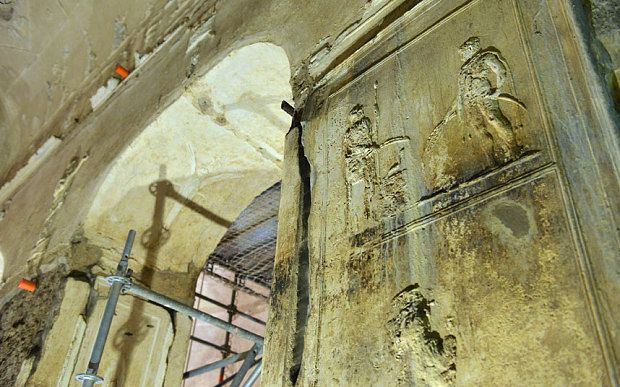Archway and stucco figures on the walls of the underground basilica> Secret Pagan Basilica in Rome Emerges from the Shadows After 2000 Years