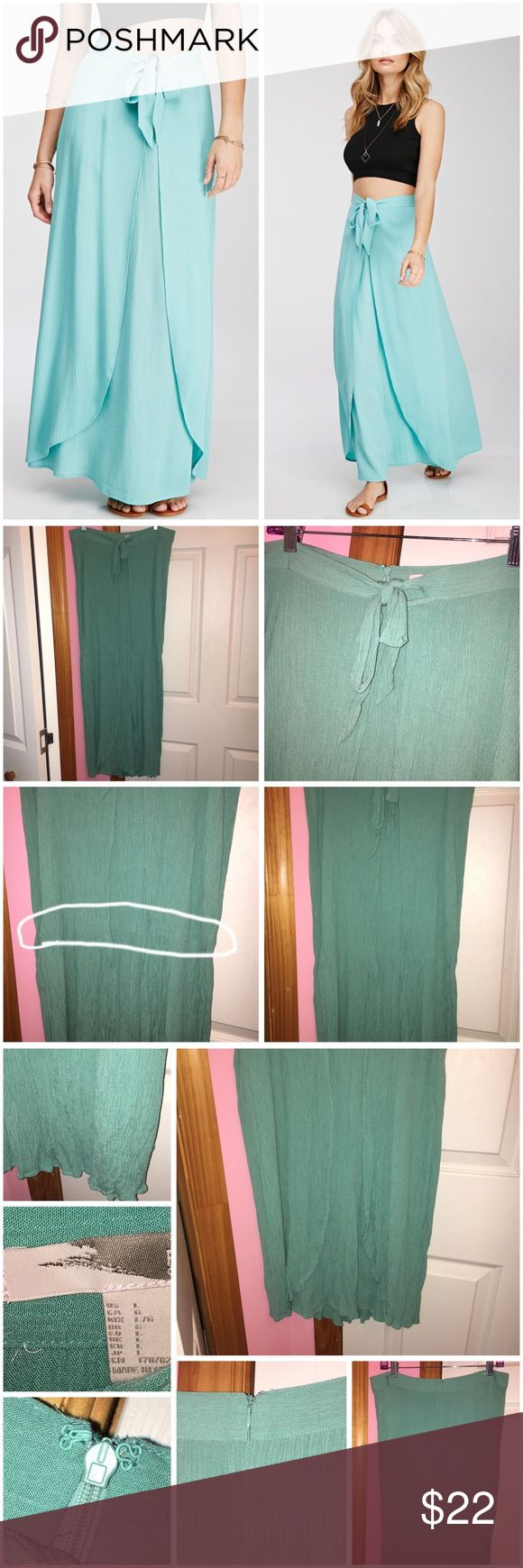 """Tulip Front Maxi Skirt Never worn; just washed. Does have hanging marks and does have a cease (circled in first photo). Forever 21 contemporary skirt. Color is sea foam. It's more green than what the stock photos shows. Tulip front with a self-tie bow at waist. Crinkled woven fabric. Concealed back zipper. Unlined. 100% rayon. Length is approx 40"""" and waist is approx 32"""" laying flat. ❌NO TRADES❌ Forever 21 Skirts Maxi"""