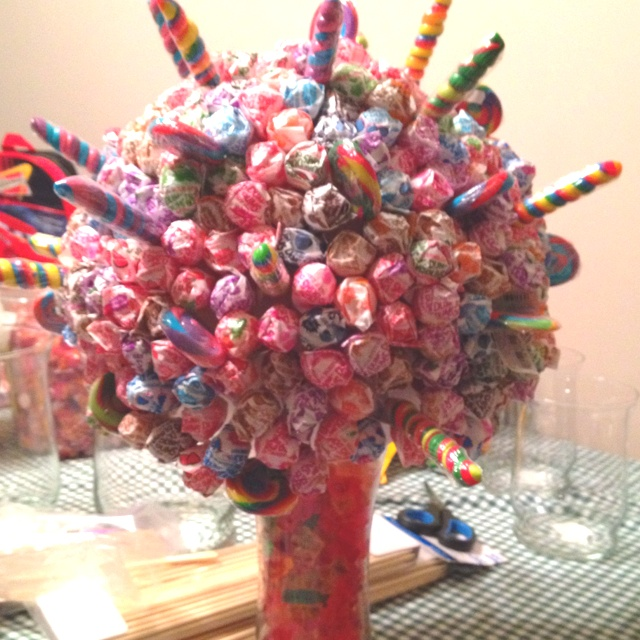 Candy sucker bouquet...suck for a buck  dum dum - 1.00  tootsie pop - 5.00  blow pop - 10.00