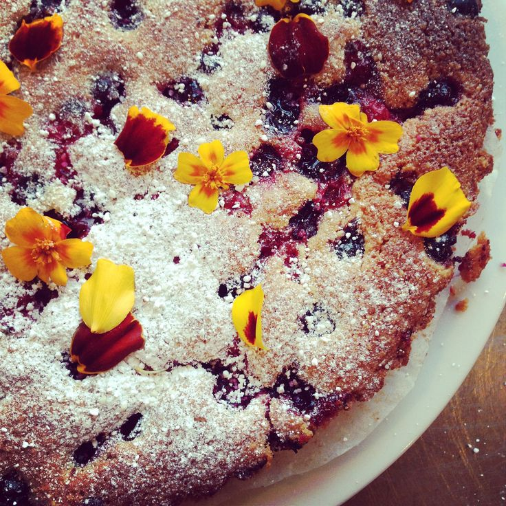 almond and blackcurrant cake with fresh tagetes petals