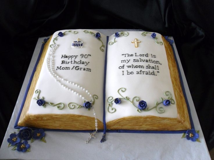 This bible was hand carved from three 1/4 sheet cakes. Covered in MMF. Buttery yellow cake with raspberry filling.