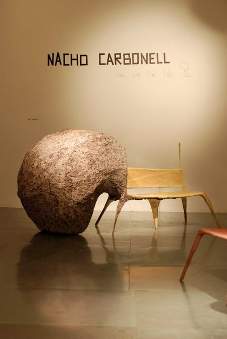 Work by artist Nacho Carbonell. A chair with a cave-like bulge that a person can climb inside for contemplation     credit: www.dezeen.com