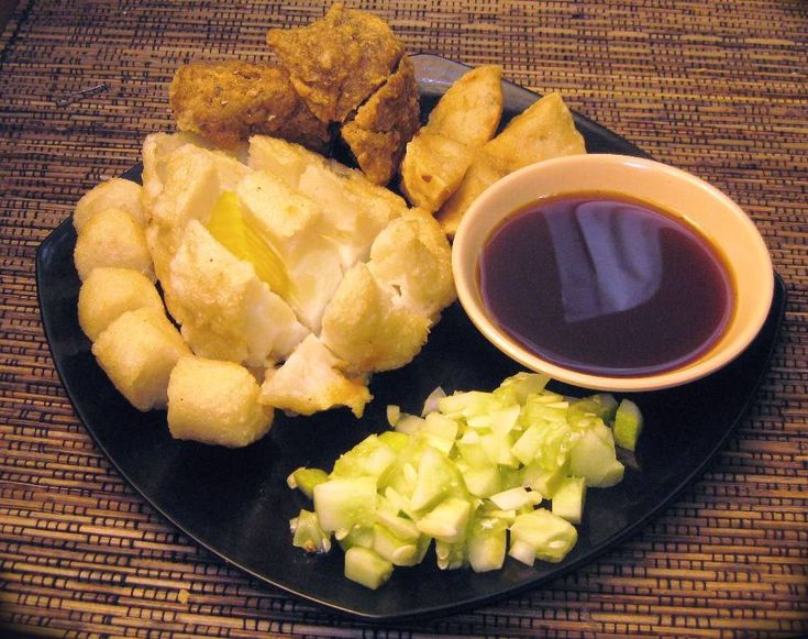 EMPEK-EMPEK. (Is a savoury fishcake delicacy from South Sumatera-Palembang, Indonesia. It is made from fish and tapioca. Pempek is served with yellow noodles and a dark, rich sweet and sour sauce called kuah cuka or kuah cuko) #PINdonesia