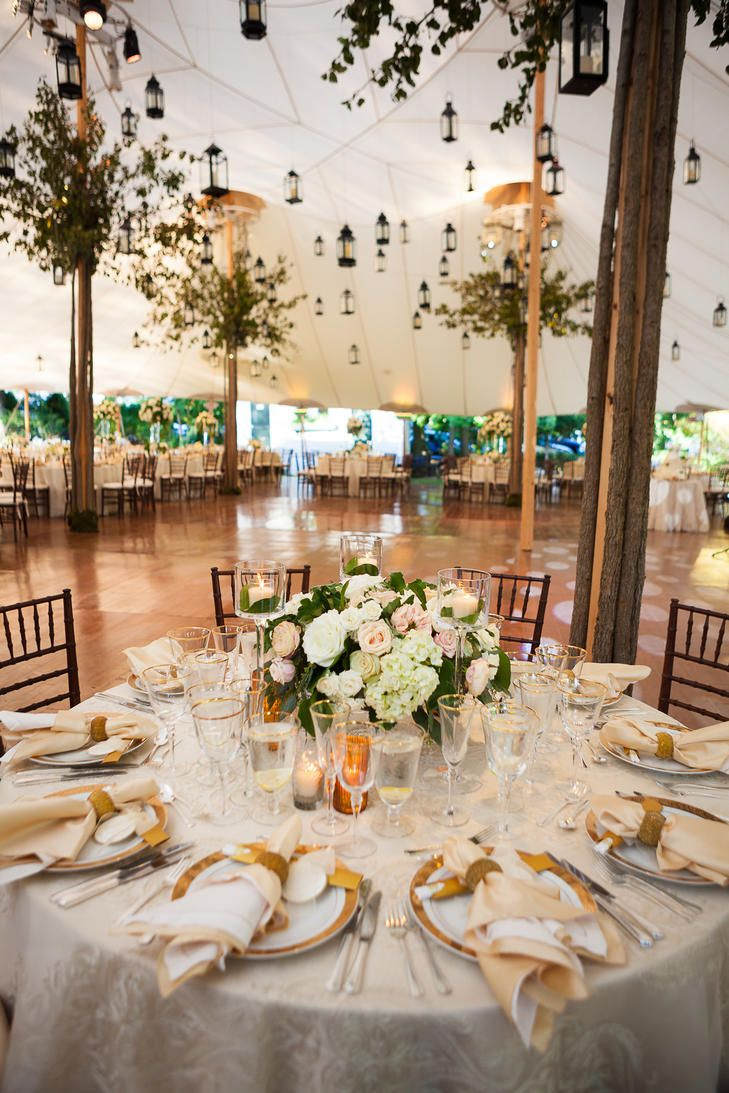 To balance the whimsical decor and garden-inspired floral arrangements, the reception tables were dressed in an elegant, old-world fashion with gold-rimmed China and stemware.