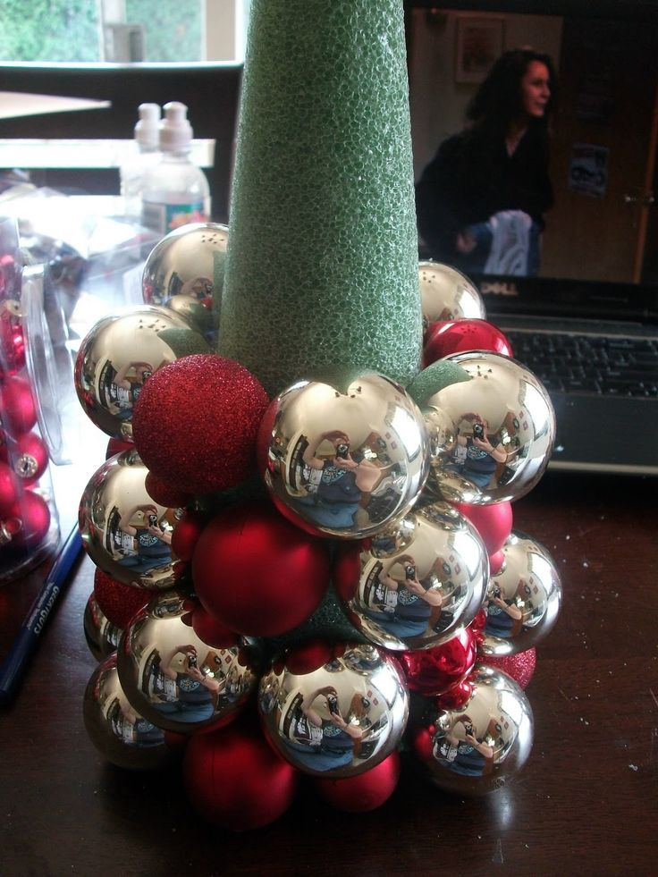 I made two of these trees. One in blue and gold and one in scarlet and grey for the OSU and MI football party. they turned out great ... I used sparkely garland first then the balls and I filled the gaps with ribbon. I am going to tell you it takes more balls than you think! I made 3 trips to the dollar store for balls. I spent around $20.00 on each.