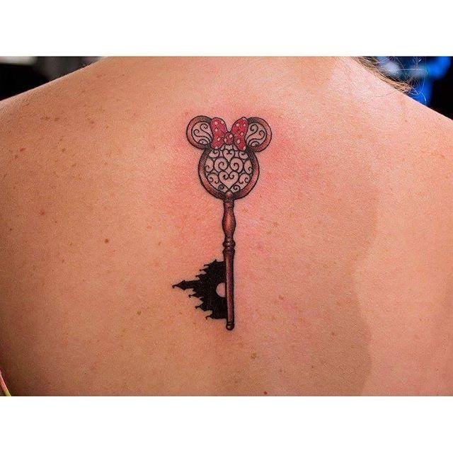 Disney key tattoo done by Jesse Myers #disneykey #tattoos #backtattoo #chickswithtattoos