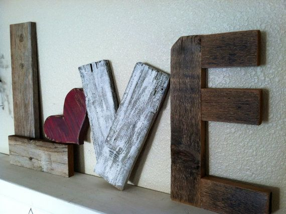 Rustic LOVE Reclaimed Wood Valentine Home Decor. $36.00, via Etsy.OR I can totally make this with the kids!