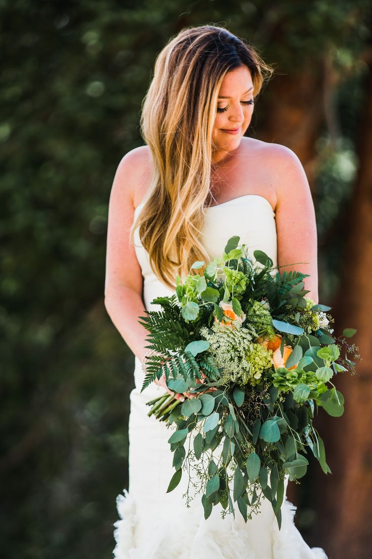 This bouquet is from a gorgeous summer wedding last July at Timber Ridge in Keystone, Colorado. Her cascading bouquet looked amazing with long greens, bells of Ireland, lots of greenery/contrast and a touch of wild roses, hydrangea, and Juliet Garden Roses.  Photo by Gillespie Photography