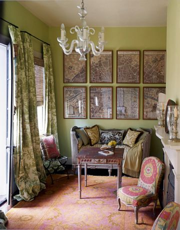 i've always loved this little sitting room by hal williamson . the pair of chairs flanking the fireplace are in ikat fabric and they work so well with the antique rug . i adore the broken map of new orleans on the far wall . new orleans . louisiana . photo by house beautiful . #thingsmatter